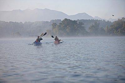 Family canoeing on lake, Staffelsee, Murnau, Oberbayern, Bavaria, Germany - p429m1022873 by Stephen Lux