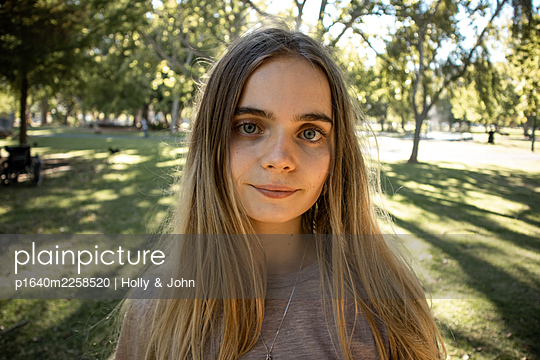 Portrait of teenage girl in a park - p1640m2258520 by Holly & John
