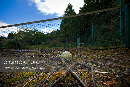 Tennis ball on old court