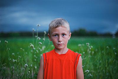 Boy in Garden - p1169m1124127 by Tytia Habing