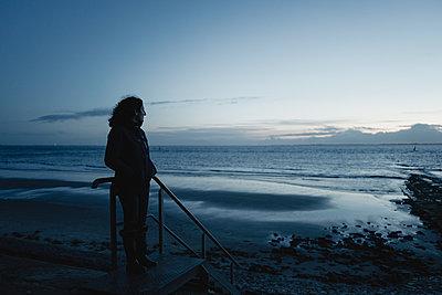 Woman at the sea - p586m2089996 by Kniel Synnatzschke