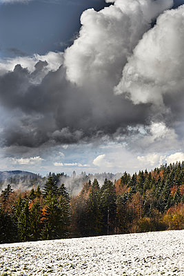 Clouds over forest in autumn - p1312m2161015 by Axel Killian