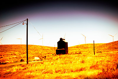 Agricultural Building and Wind Turbines in Rural Landscape , Oregon, USA - p694m2218852 by Justin Hill photography