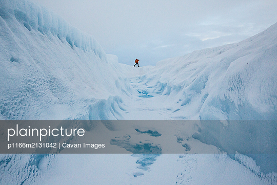 Hiker on adventure exploring the ice cap of Greenland - p1166m2131042 by Cavan Images