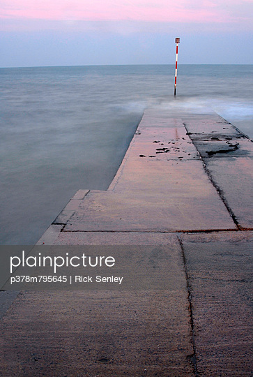 Sea and concrete slabs - p378m795645 by Rick Senley