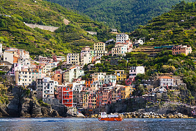 Riomaggiore, a fishing village with colourful apartment buildings, part of the Cinque Terre hamlets on the Italian Riviera coastline; Riomaggiore, La Spezia province, Italy - p442m1449112 by Perry Mastrovito