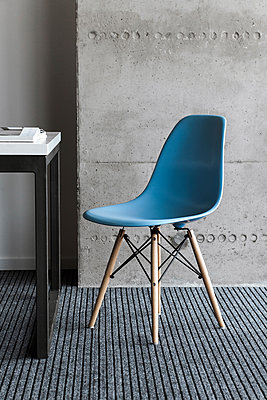 Blue chair by desk - p1427m2077604 by Mykhailo Lukashuk