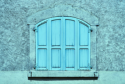 Window with closed shutters - p1312m2150476 by Axel Killian