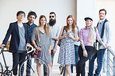 Group of hipsters standing together outdoors - p623m1221245 by Eric Audras
