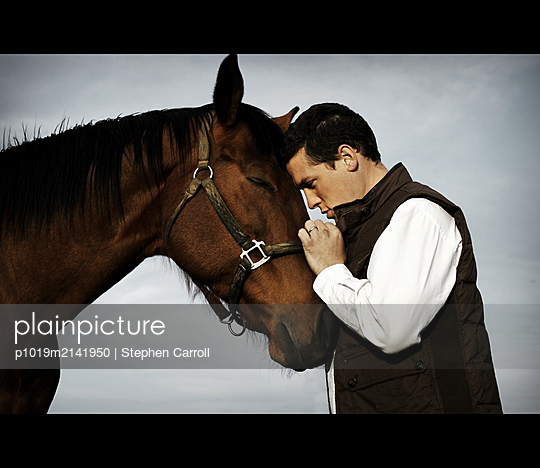 Man with horse - p1019m2141950 by Stephen Carroll