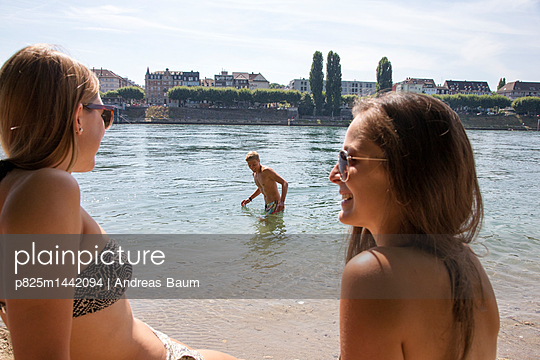 Young people take a swim in the river