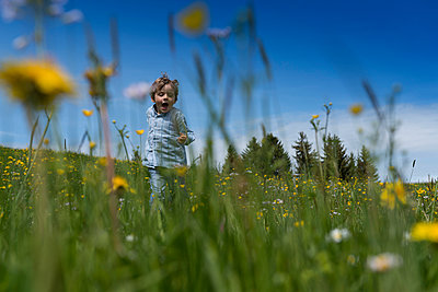 Child running on a meadow - p282m953215 by Holger Salach