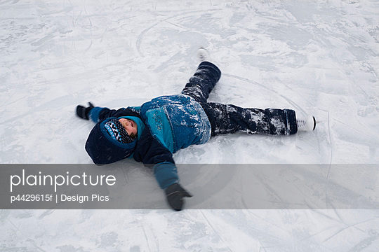 Child making snow angel