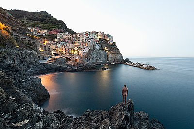 Naked man looks at Manarola - p1383m1511309 by Wolfgang Steiner