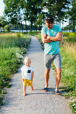 Father with son walking - p312m2050141 by Anna Rostrom