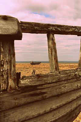 Vintage wooden boats on the beach - p1063m1134980 by Ekaterina Vasilyeva