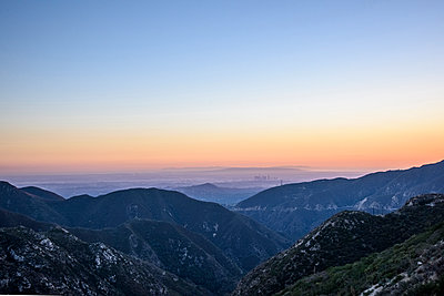 Scenic view of mountains against clear sky during sunset - p1166m1533842 by Cavan Images