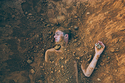 Buried Man and Flowers - p1262m1072837 by Maryanne Gobble
