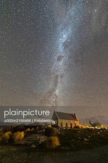 New Zealand, Oceania, South Island, Lake Tekapo, Church of the Good Shepherd and Milky Way on sky at night - p300m2166466 by Fotofeeling