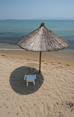 Parasol on the beach - p147m1093100 by Peter Stüber