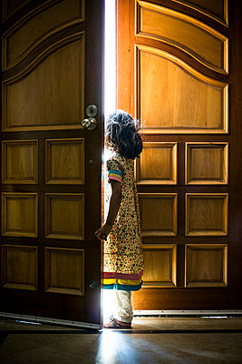 Little girl standing by the door  - p794m1034123 by Mohamad Itani