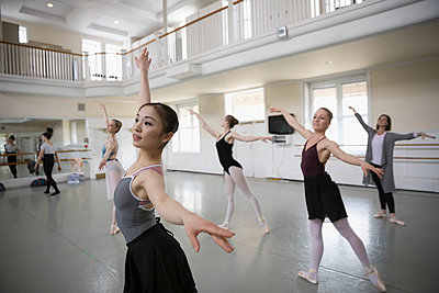 Female ballet dancers practicing in dance studio - p1192m1403467 by Hero Images
