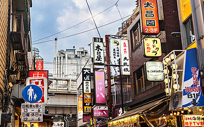 Marketing signs on buildings, Japan - p312m2091304 by Pernille Tofte