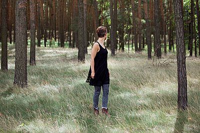 Woman in a forest - p432m702630 by mia takahara