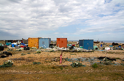 Cargo containers and fishing debris on Romney Marsh, Dungeness, Kent, UK - p855m713458 by Robert Greshoff