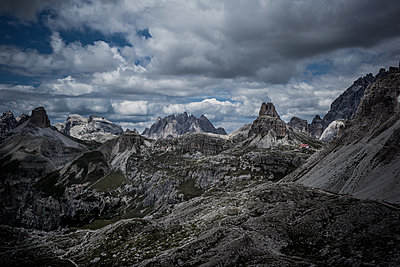 Mountain range in the Dolomites with dark clouds - p741m2077000 by Christof Mattes