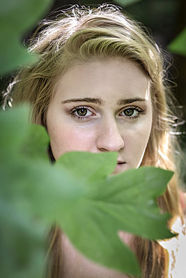 Blonde in foliage  - p1019m1480993 by Stephen Carroll