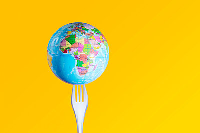 Globe on plastic fork - p1149m2115356 by Yvonne Röder