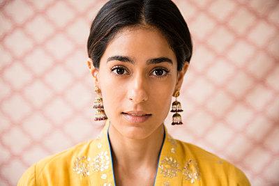 Indian woman wearing earrings - p555m1305069 by JGI/Jamie Grill