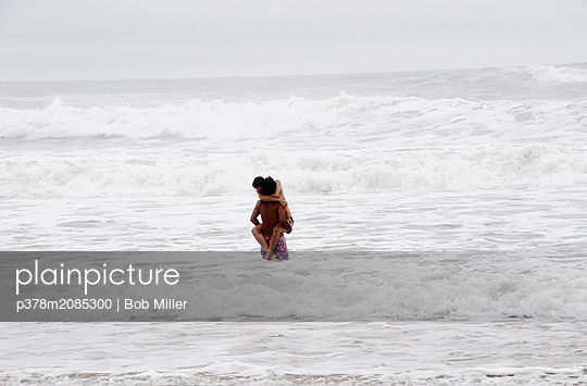 Lovers in the sea - p378m2085300 by Bob Miller