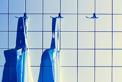 Aprons hanging on coat hooks in dissecting room - p300m1023549f by Dieter Schewig