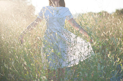 Woman in Tall Grass - p920m989894 by Jude Mooney