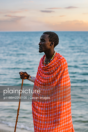 Maasai Man on the beach - p1166m2200100 by Cavan Images