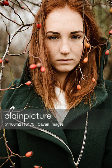 Close-up portrait of teenage girl with red hair - p1166m2113175 by Cavan Images