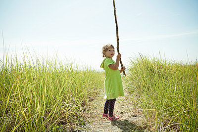 Portrait of female toddler holding long stick - p924m884301f by Robyn Breen Shinn