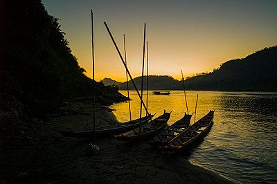 Sunset over Mekong River, Luang Prabang - p934m1022211 by Sebastien Loffler