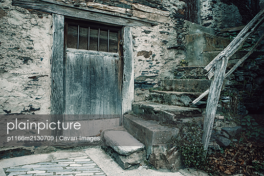 Old stone village in the mountains - p1166m2130709 by Cavan Images