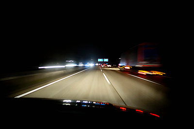 Driving at night on Autobahn - p300m1018945f by Nabiha Dahhan