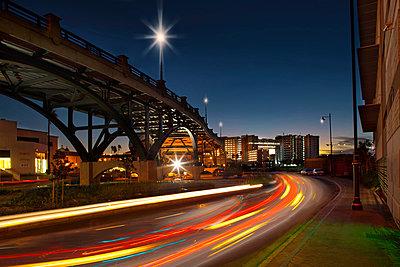 Traffic on street through city at night, long exposure - p429m824424 by Zero Creatives