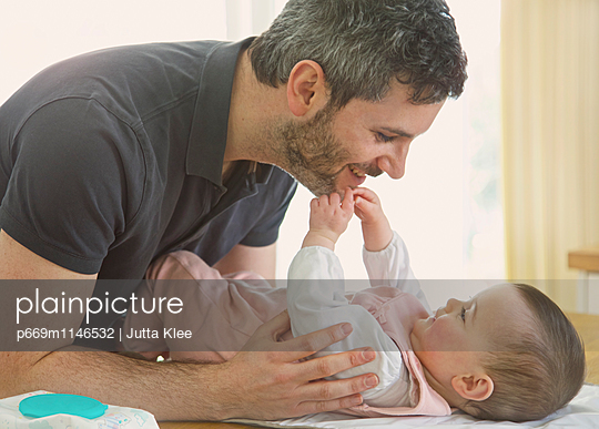 Baby Girl Touching Father Face - p669m1146532 by Jutta Klee photography