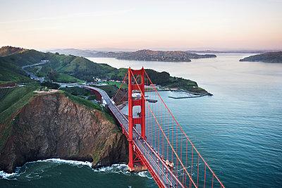 Aerial view of Golden Gate Bridge over San Francisco Bay against sky - p1166m1164444 by Cavan Images