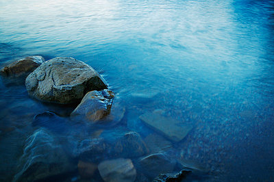 A stony river bed - p4421604f by Design Pics