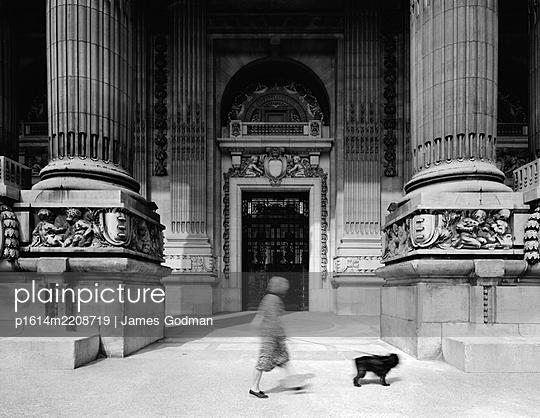 Woman walking dog in front of The Grand Palais des Champs-Élysées - p1614m2208719 by James Godman