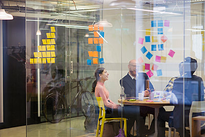 Creative business people brainstorming in conference room meeting - p1023m2009650 by Sam Edwards