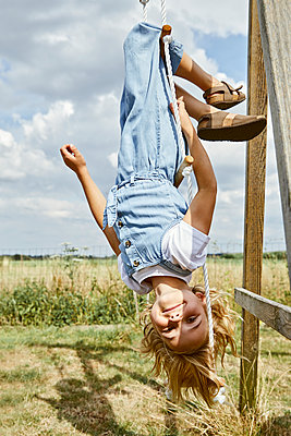 Little girl playing on a rope ladder - p1540m2200522 by Marie Tercafs