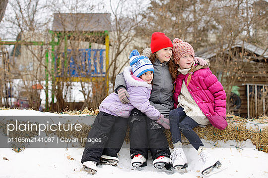 Friends Taking a Break from Ice Skating - p1166m2141097 by Cavan Images